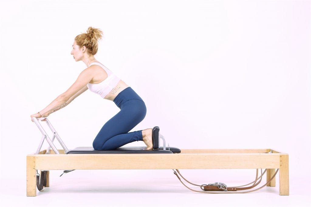 Knee Stretches on the Reformer Round